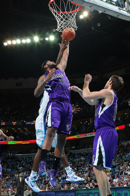 NEW ORLEANS, LA - DECEMBER 15:  DeMarcus Cousins #15 of the Sacramento Kings grabs a rebound during the game against the New Orleans Hornets  at the New Orleans Arena on December 15, 2010 in New Orleans, Louisiana.  The Hornets defeated the Kings 94-91.