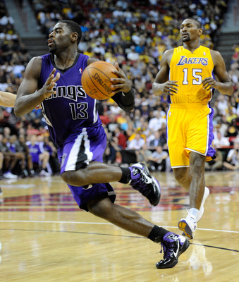 LAS VEGAS - OCTOBER 13:  Tyreke Evans #13 of the Sacramento Kings drives ahead of Ron Artest #15 of the Los Angeles Lakers during their preseason game at the Thomas & Mack Center October 13, 2010 in Las Vegas, Nevada. The Lakers won 98-95. NOTE TO USER: U
