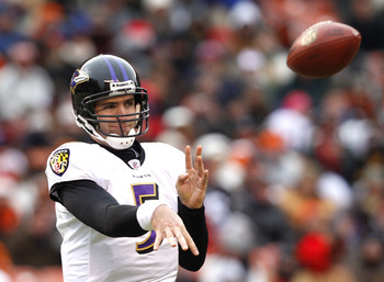 CLEVELAND - DECEMBER 26:  Quarterback Joe Flacco #5 of the Baltimore Ravens throws to a receiver against the Cleveland Browns at Cleveland Browns Stadium on December 26, 2010 in Cleveland, Ohio.  (Photo by Matt Sullivan/Getty Images)