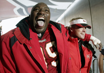 TAMPA, FL - JANUARY 12:  Defensive tackle Warren Sapp #99 and head coach Jon Gruden of the Tampa Bay Buccaneers celebrate their victory over the San Francisco 49ers in the NFC Divisional Playoff game at Raymond James Stadium on January 12, 2002 in Tampa,