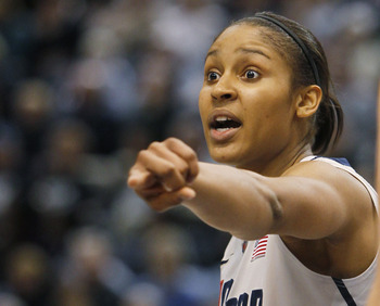 HARTFORD, CT - DECEMBER 21:  Maya Moore #23 of the Connecticut shouts instructions in the final minutes of a win over Florida State on December 21, 2010 in Hartford, Connecticut.  Connecticut set a record with 89 straight wins without a defeat. (Photo by