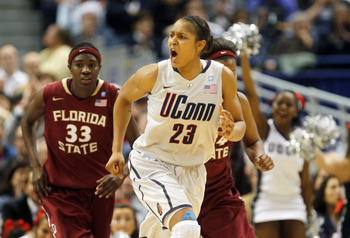 HARTFORD, CT - DECEMBER 21:  Maya Moore #23 of the Connecticut reacts in the final minutes of a win over Florida State on December 21, 2010 in Hartford, Connecticut.  Connecticut set a record with 89 straight wins without a defeat. (Photo by Jim Rogash/Ge