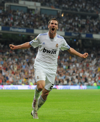 MADRID, SPAIN - SEPTEMBER 21:  Gonzalo Higuain  of Real Madrid celebrates scoring Real's second goal during the La Liga match between Real Madrid and Espanyol at Estadio Santiago Bernabeu on September 21, 2010 in Madrid, Spain.  (Photo by Denis Doyle/Gett
