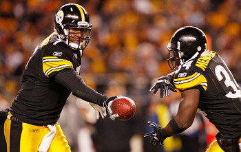 PITTSBURGH - DECEMBER 23:  Ben Roethlisberger #7 of the Pittsburgh Steelers hands the ball off to teammate Rashard Mendenhall #34 during the game against  the Carolina Panthers on December 23, 2010 at Heinz Field in Pittsburgh, Pennsylvania.  (Photo by Ja