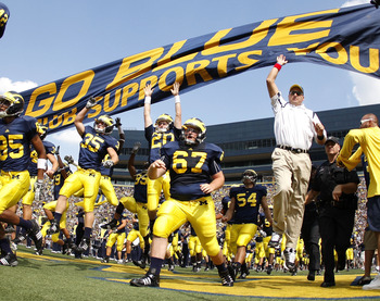ANN ARBOR, MI - SEPTEMBER 05:  Head coach Rich Rodriguez enters the stadium with his team prior to playing the Western Michigan Broncos on September 5, 2009 at Michigan Stadium in Ann Arbor, Michigan.  (Photo by Gregory Shamus/Getty Images)