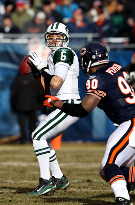 CHICAGO, IL - DECEMBER 26: Mark Sanchez #6 of the New York Jets looks for a receiver as Julius Peppers #90 of the Chicago Bears rushes at Soldier Field on December 26, 2010 in Chicago, Illinois. The Bears defeated the Jets 38-34. (Photo by Jonathan Daniel