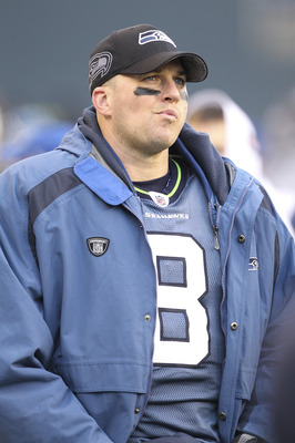SEATTLE - DECEMBER 19:  Quarterback Matt Hasselbeck #8 of the Seattle Seahawks looks on from the bench after being removed from the game in the second half against the Atlanta Falcons at Qwest Field on December 19, 2010 in Seattle, Washington. The Falcons