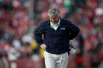 SAN FRANCISCO - DECEMBER 12:    Pete Carroll of the Seattle Seahawks looks on against the San Francisco 49ers during an NFL game at Candlestick Park on December 12, 2010 in San Francisco, California.  (Photo by Jed Jacobsohn/Getty Images)