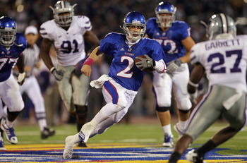 LAWRENCE, KS - OCTOBER 14:  Quarterback Jordan Webb #2 of the Kansas Jayhawks scrambles as David Garrett #27 of the Kansas State Wildcats defends during the game on October 14, 2010 at Memorial Stadium in Lawrence, Kansas.  (Photo by Jamie Squire/Getty Im