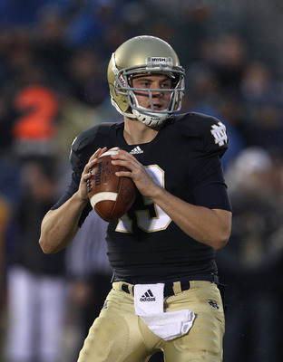 SOUTH BEND, IN - NOVEMBER 13: Tommy Rees #13 of the Notre Dame Fighting Irish looks for a receiver against the Utah Utes at Notre Dame Stadium on November 13, 2010 in South Bend, Indiana. Notre Dame defeated Utah 28-3. (Photo by Jonathan Daniel/Getty Imag
