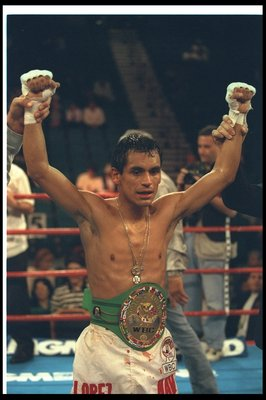 9 Nov 1996:  Ricardo Lopez celebrates after a bout against Morgan Nduma at the MGM Grand Hotel in Las Vegas, Nevada.  Lopez won the fight with a TKO in the sixth round. Mandatory Credit: Al Bello  /Allsport