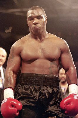 20 Oct 2000:  Mike Tyson moves into a corner during the fight against Andrew Golota at the Palace of Auburn Hills in Auburn, Michigan. Tyson defeated Golota in the third round by technical knockout.Mandatory Credit: Al Bello  /Allsport