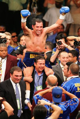LAS VEGAS - MAY 06:  Oscar De La Hoya celebrates after defeating Ricardo Mayorga during the WBC super welterweight title fight at the MGM Grand Garden Arena May 6, 2006 in Las Vegas, Nevada.  Oscar De La Hoya defeated Ricardo Mayorga by technical knockout