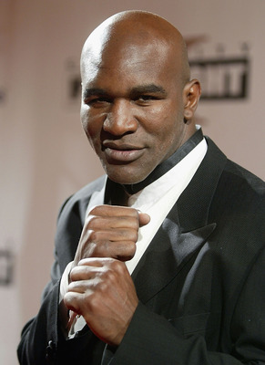 PHOENIX, AZ - MARCH 27: Boxer Evander Holyfield arrives at 'Celebrity Fight Night X', a charity event to raise money for the Muhammad Ali Parkinson Research Center at Barrow Neurological Institute March 27, 2004, in Pheonix, Arizona. The 'Muhammad Ali Awa