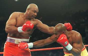 5 NOV 1994:  GEORGE FOREMAN THROWS A LEFT AT  MICHAEL MOORER TONIGHT DURING THE FIRST ROUND OF THEIR WBA/IBF HEAVYWEIGHT TITLE FIGHT AT THE MGM GRAND IN LAS VEGAS, NEVADA.  FOREMAN WENT ON TO WIN THE FIGHT, AND THE TITLES, WITH A 10TH ROUND KNOCK OUT. Man