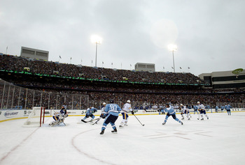 ORCHARD PARK, NY - JANUARY 01:  Weather looms as the Buffalo Sabres get the puck out of their zone in the second period of the NHL Winter Classic against the Pittsburgh Penguins at the Ralph Wilson Stadium on January 1, 2008 in Orchard Park, New York.   T