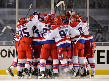 PITTSBURGH, PA - JANUARY 01:  The Washington Capitals celebrate their 3-1 victory over the Pittsburgh Penguins during the 2011 NHL Bridgestone Winter Classic at Heinz Field on January 1, 2011 in Pittsburgh, Pennsylvania.  (Photo by Jamie Sabau/Getty Image