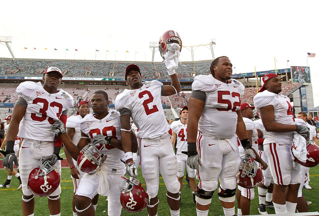 ORLANDO, FL - JANUARY 01:  Players from the Alabama Crimson Tide greet fans after winning the Capitol One Bowl against the Michigan State Spartans at the Florida Citrus Bowl on January 1, 2011 in Orlando, Florida.  (Photo by Mike Ehrmann/Getty Images)