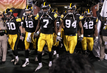 TEMPE, AZ - DECEMBER 28:  (L-R) De'Andre Johnson #30, Ricky Stanzi #12, Marvin McNutt #7, Adrian Clayborn #94 and Jeremiha Hunter #42 of the Iowa Hawkeyes walk out onto the field for the Insight Bowl against the Missouri Tigers at Sun Devil Stadium on Dec