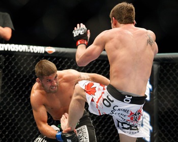 MONTREAL- MAY 8: Sam Stout (R) kicks Jeremy Stephens in their lightweight 'swing' bout at UFC 113 at Bell Centre on May 8, 2010 in Montreal, Quebec, Canada.  (Photo by Richard Wolowicz/Getty Images)
