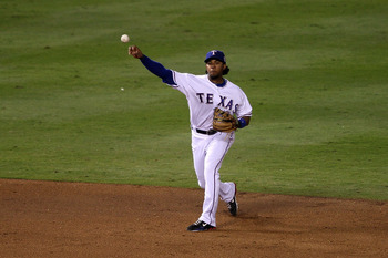 ARLINGTON, TX - NOVEMBER 01:  Elvis Andrus #1 of the Texas Rangers throws the ball to first base against the San Francisco Giants in Game Five of the 2010 MLB World Series at Rangers Ballpark in Arlington on November 1, 2010 in Arlington, Texas.  (Photo b