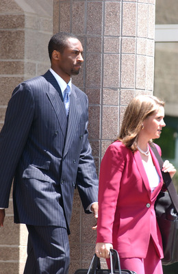 EAGLE, CO- JULY 19: Los Angeles Lakers star Kobe Bryant and his attorney Pamela Mackey leave for a lunch break at the Eagle County Courthouse July 19, 2004 in Eagle, Colorado. Lawyers for Bryant want the judge to allow cell phone text messages between the