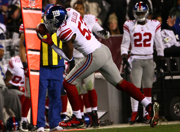 LANDOVER, MD - JANUARY 02:  Linebacker Keith Bulluck #53 of the New York Giants intercepts a pass against the Washington Redskins during their game at FedEx Field on January 2, 2011 in Landover, Maryland. The Giants won the game 17-14.  (Photo by Win McNa