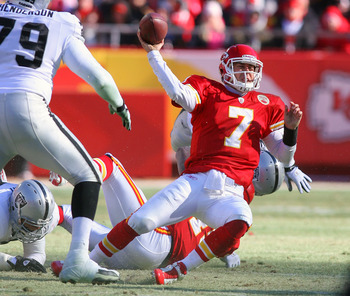 KANSAS CITY, MO - JANUARY 02:  Quarterback Matt Cassel #7 of the Kansas City Chiefs throws a pass while falling down in a game against the Oakland Raiders at Arrowhead Stadium on January 2, 2011 in Kansas City, Missouri.  (Photo by Tim Umphrey/Getty Image