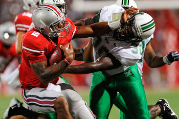COLUMBUS, OH - SEPTEMBER 2:  Terrelle Pryor #2 of the Ohio State Buckeyes stiff arms Mario Harvey #30 of the Marshall Thundering Herd at Ohio Stadium on September 2, 2010 in Columbus, Ohio.  (Photo by Jamie Sabau/Getty Images)