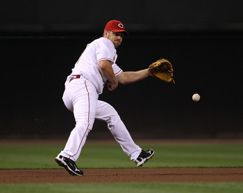 CINCINNATI - OCTOBER 10: Scott Rolen #27 of the Cincinnati Reds fields the ball against the Philadelphia Phillies during game 3 of the NLDS at Great American Ball Park on October 10, 2010 in Cincinnati, Ohio. The Phillies defeated the Reds 2-0. (Photo by