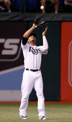 ST PETERSBURG, FL - SEPTEMBER 27:  Outfielder Carl Crawford #13 of the Tampa Bay Rays catches a fly ball against the Baltimore Orioles during the game at Tropicana Field on September 27, 2010 in St. Petersburg, Florida.  (Photo by J. Meric/Getty Images)