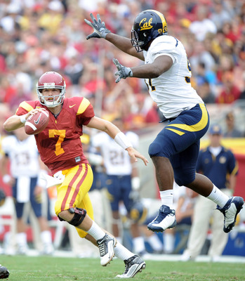 LOS ANGELES, CA - OCTOBER 16:  Matt Barkley #7 of the USC Trojans eludes the rush of Cameron Jordan #97 of the California Golden Bears during the first quarter at Los Angeles Memorial Coliseum on October 16, 2010 in Los Angeles, California.  (Photo by Har