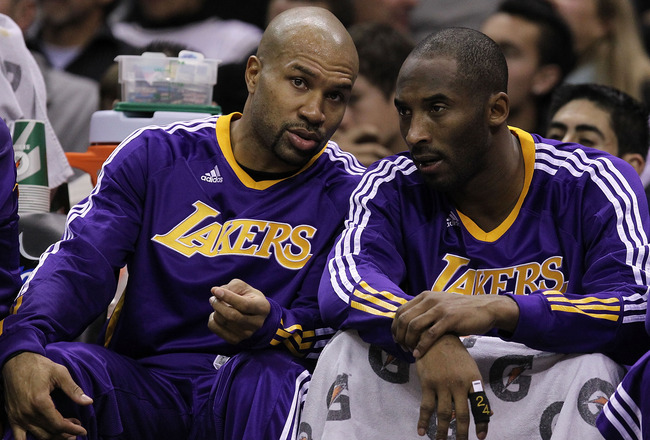 SAN ANTONIO, TX - DECEMBER 28:  Guard Derek Fisher #2 and Kobe Bryant #24 of the Los Angeles Lakers at AT&T Center on December 28, 2010 in San Antonio, Texas.  NOTE TO USER: User expressly acknowledges and agrees that, by downloading and/or using this pho