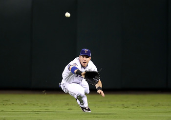 ARLINGTON, TX - OCTOBER 31:  Josh Hamilton #32 of the Texas Rangers makes a diving catch in the second inning against the San Francisco Giants in Game Four of the 2010 MLB World Series at Rangers Ballpark in Arlington on October 31, 2010 in Arlington, Tex