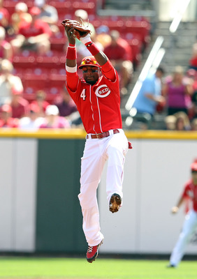 CINCINNATI - SEPTEMBER 12: Brandon Phillips #4 of the Cincinnati Reds leaps to catch a ball for an out  during the game against the Pittsburgh Pirates at Great American Ballpark on September 12, 2010 in Cincinnati, Ohio.  (Photo by Andy Lyons/Getty Images
