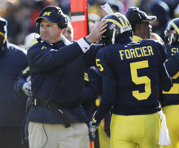 ANN ARBOR, MI - NOVEMBER 06:  Tate Forcier #5 of the Michigan Wolverines is congratulated by head coach Rich Rodriguez after scoring an overtime touchdown while playing the Illinios Fighting Illini at Michigan Stadium on November 6, 2010 in Ann Arbor, Mic
