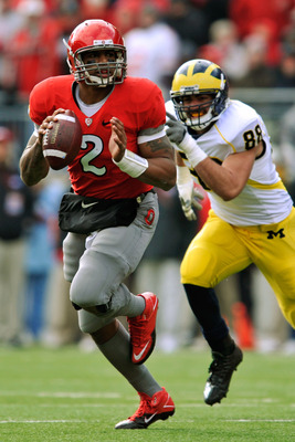 COLUMBUS, OH - NOVEMBER 27:  Quarterback Terrelle Pryor #2 of the Ohio State Buckeyes rolls out of the pocket looking for his receiver as Craig Roh #88 of the Michigan Wolverines pursues at Ohio Stadium on November 27, 2010 in Columbus, Ohio.  (Photo by J