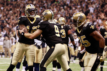 NEW ORLEANS, LA - DECEMBER 12:  Drew Brees #9 and Marques Colston #12 of the New Orleans Saints celebrate after scoring a touchdown against the St. Louis Rams at the Louisiana Superdome on December 12, 2010 in New Orleans, Louisiana. The Saints defeated t