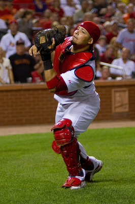 ST. LOUIS - AUGUST 21: Yadier Molina #4 of the St. Louis Cardinals catches a fly ball against the San Francisco Giants at Busch Stadium on August 21, 2010 in St. Louis, Missouri.  (Photo by Dilip Vishwanat/Getty Images)