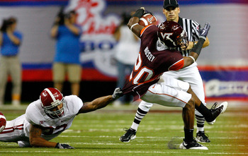 ATLANTA - SEPTEMBER 05:  Cornerback Jayron Hosley #20 of the Virginia Tech Hokies breaks a tackle by Eryk Anders #32 of the Alabama Crimson Tide during the Chick-fil-A Kickoff Game at Georgia Dome on September 5, 2009 in Atlanta, Georgia.  (Photo by Kevin