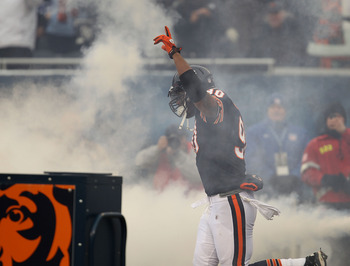 CHICAGO, IL - DECEMBER 26: Julius Peppers #90 of the Chicago Bears runs onto the field during player introductions before a game against the New York Jets at Soldier Field on December 26, 2010 in Chicago, Illinois. The Bears defeated the Jets 38-34.  (Pho