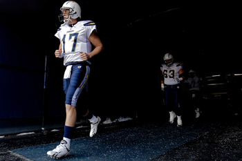 DENVER, CO - JANUARY 2:  Quarterback Philip Rivers #17 of the San Diego Chargers leads teammates center Scott Mruczkowski #63 and quarterback Billy Volek #7 out of the tunnel before a game against the Denver Broncos at INVESCO Field at Mile High on Januar