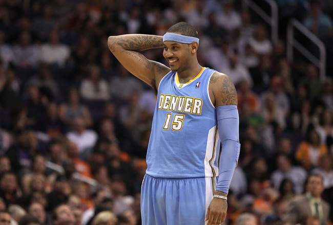 PHOENIX - NOVEMBER 15:  Carmelo Anthony #15 of the Denver Nuggets during the NBA game against the Phoenix Suns at US Airways Center on November 15, 2010 in Phoenix, Arizona.  The Suns defeated the Nuggets 100-94.  NOTE TO USER: User expressly acknowledges