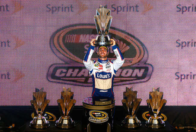 HOMESTEAD, FL - NOVEMBER 21:  Jimmie Johnson, driver of the #48 Lowe's Chevrolet, celebrates after finishing in second place in the Ford 400 to clinch his fifth consecutive NASCAR Sprint Cup championship at Homestead-Miami Speedway on November 21, 2010 in