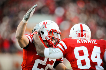 LINCOLN, NE - NOVEMBER 26: Rex Burkhead #22 of the Nebraska Cornhuskers celebrates his touchdown pass with Brandon Kinnie #84   during their game at Memorial Stadium on November 26, 2010 in Lincoln, Nebraska. Nebraska defeated Colorado 45-17 (Photo by Eri