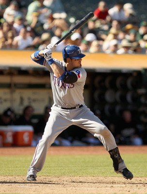 OAKLAND, CA - SEPTEMBER 25:  Jorge Cantu #8 of the Texas Rangers bats against the Oakland Athletics at the Oakland-Alameda County Coliseum on September 25, 2010 in Oakland, California.  (Photo by Ezra Shaw/Getty Images)