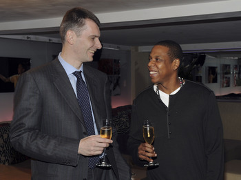NEW YORK - MAY 18:  (EXCLUSIVE) Nets owner Mikhail Prokhorov with cultural icon and Nets investor JAY-Z celebrate Prokhorov's purchase of the team at lunch today at JAY-Z's 40/40 club on May 18, 2010 in New York City. Prokhorov is representing the Nets to