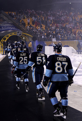 PITTSBURGH, PA - JANUARY 01:  Sidney Crosby #87 of the Pittsburgh Penguins walks off the ice with teammates after being defeated 3-1 by the Washington Capitals during the 2011 NHL Bridgestone Winter Classic at Heinz Field on January 1, 2011 in Pittsburgh,