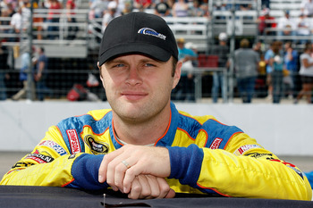 LOUDON, NH - SEPTEMBER 19:  Travis Kvapil, driver of the #38 Long John Silver's Ford, stands on the grid during the NASCAR Sprint Cup Series Sylvania 300 at New Hampshire Motor Speedway on September 19, 2010 in Loudon, New Hampshire.  (Photo by Tom Whitmo