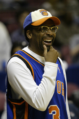 EAST RUTHERFORD, NJ - APRIL 17:  Director/Die-hard New York Knicks fan Spike Lee smiles during Game One of the Eastern Conference Quarterfinals of the 2004 NBA Playoffs against the New Jersey Nets on April 17, 2004 at the Continental Airlines Arena in Eas
